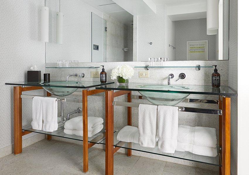 Deluxe Queen bathroom with dual vanity sinks