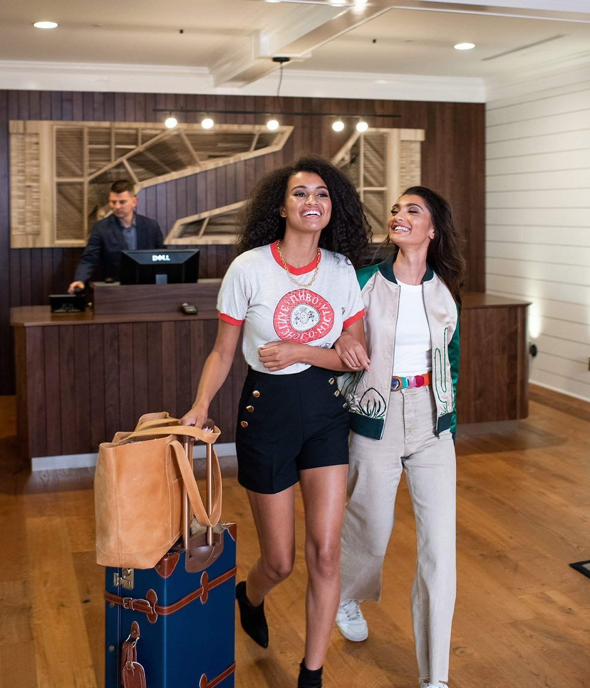 Two women checking in at reception